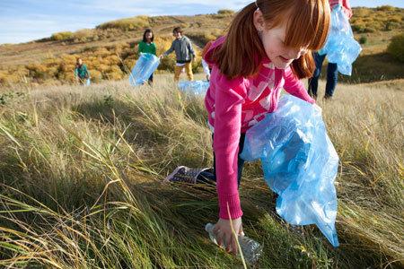 Children collecting plastic water bottles