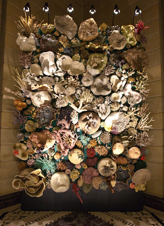"""Our Changing Seas: A Coral Reef Story,"" by Courtney Mattison, shows a coral reef in transition from health (at bottom) to bleaching and degradation."