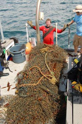 Crew hauling net onto stern