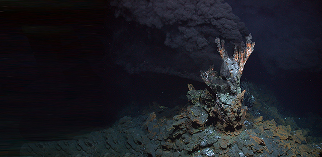 """Black Smoker"" - active hydrothermal vents emitting sulphide. Credit: MARUM Forschungszentrum Ozeanrander, Universitat Bremen, https://picasaweb.google.com/109421560750700623225/BlackSmoker"