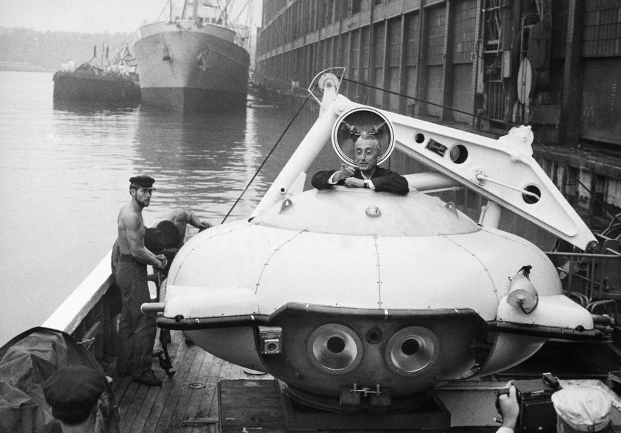 Jacques Cousteau (1910-1997) climbing into his Diving Saucer on board the 'Calypso' docked in New York Harbor in August 1959.