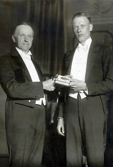 U.S. president Calvin Coolidge presented the National Geographic Society's Hubbard Medal to Aviator Charles Lindbergh in 1928. (copyright expired)