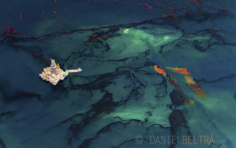 Oil released from the failed Deepwater Horizon wellhead rises up to the surface of the Gulf of Mexico amidst an offshore platform drilling a relief well.