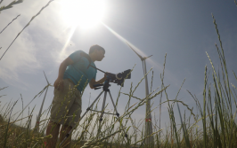 Jonah Bryson filming a field of wind turbines in Germany. © 2015