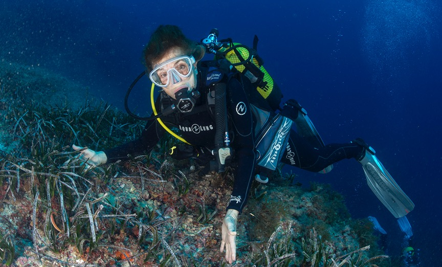 Dr. Sylvia Earle exploring a seagrass bed in the marine protected area of the small island of El Toro off the coast of Mallorca. Photo © Kip Evans for Mission Blue.