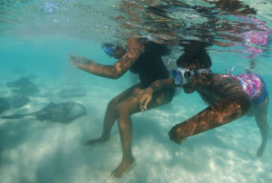 Students in Bimini, The Bahamas meeting Southern stingrays (c) Jillian Morris